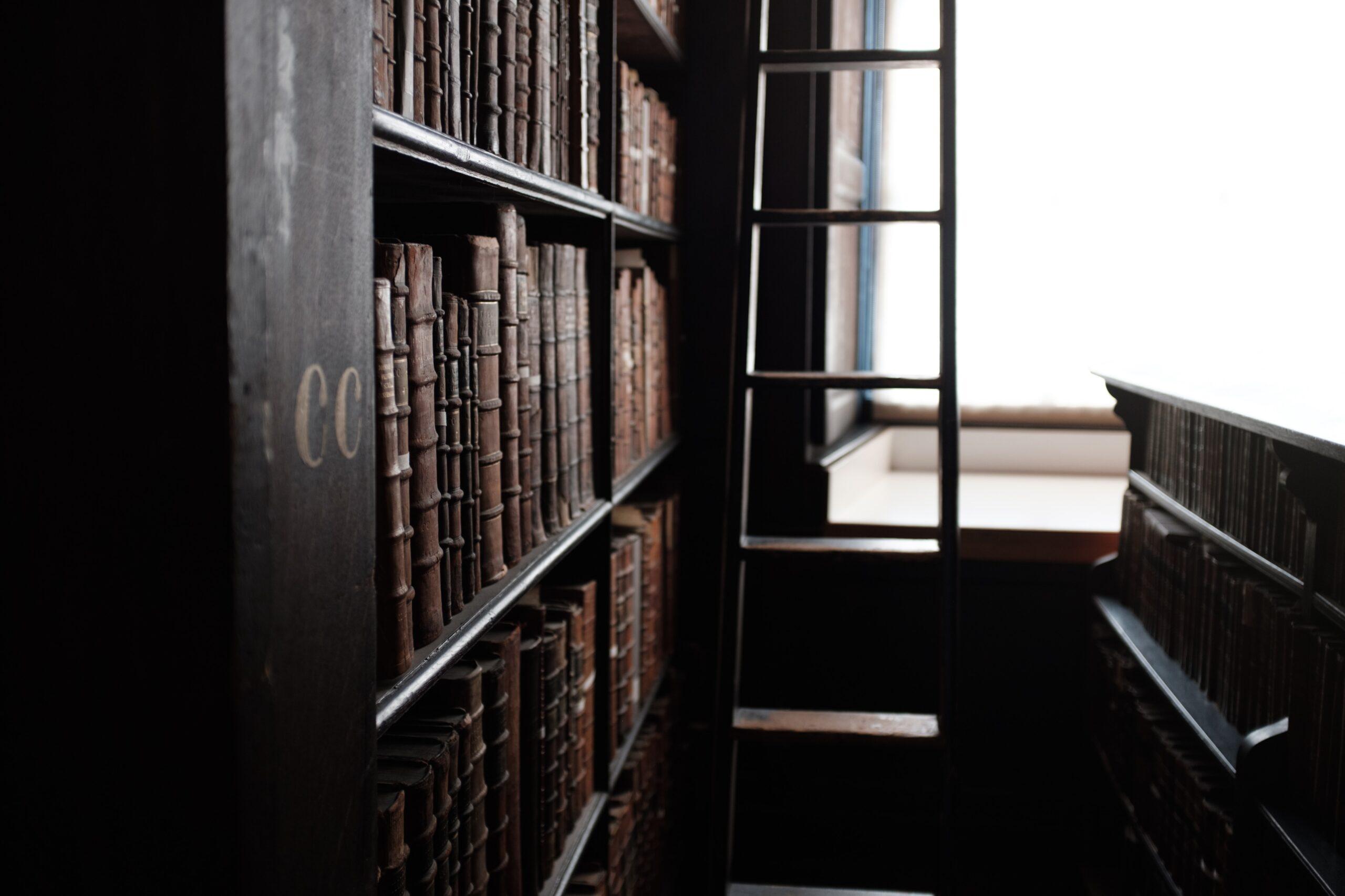 photo of a ladder next to a bookshelf