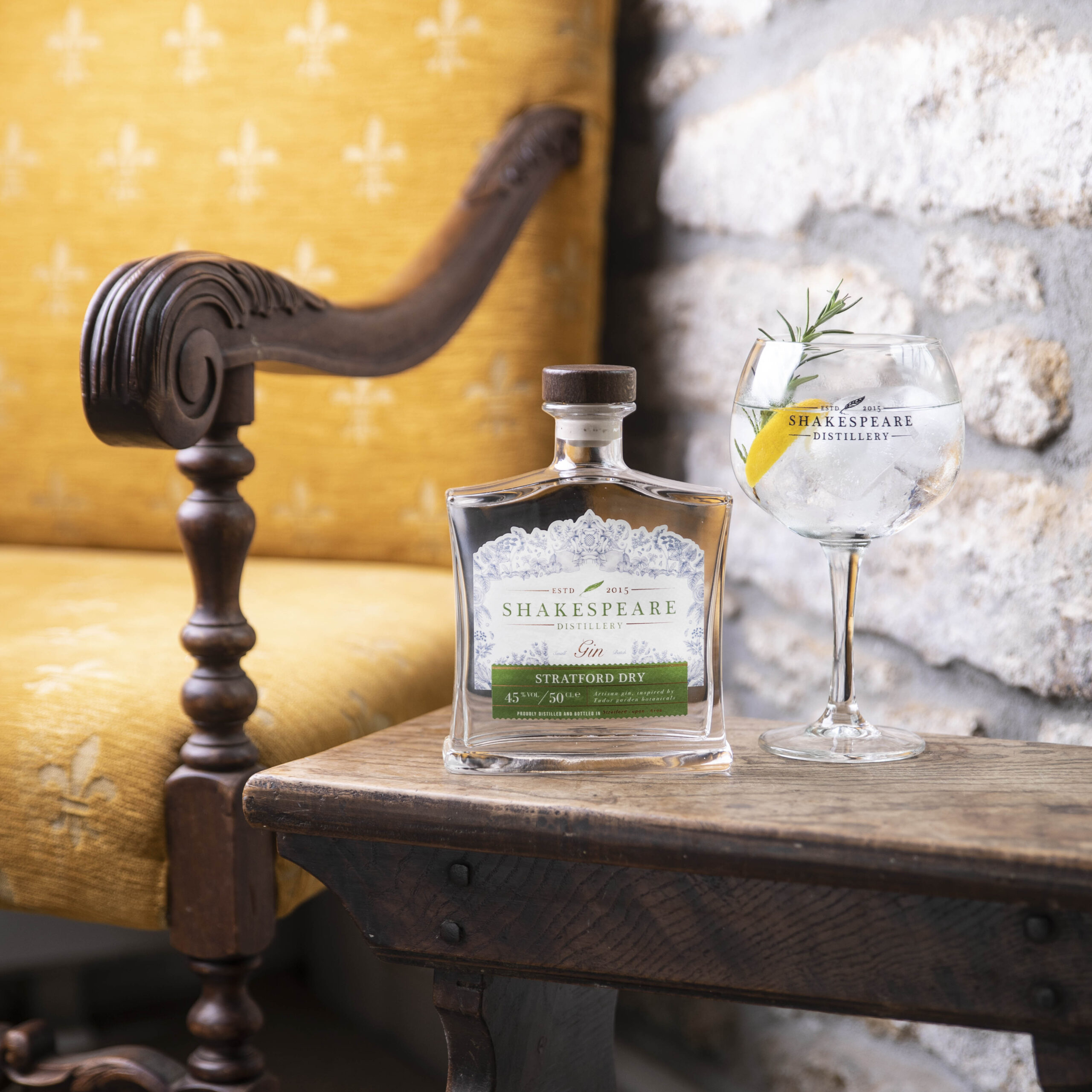 a bottle of stratford dry gin next to a glass